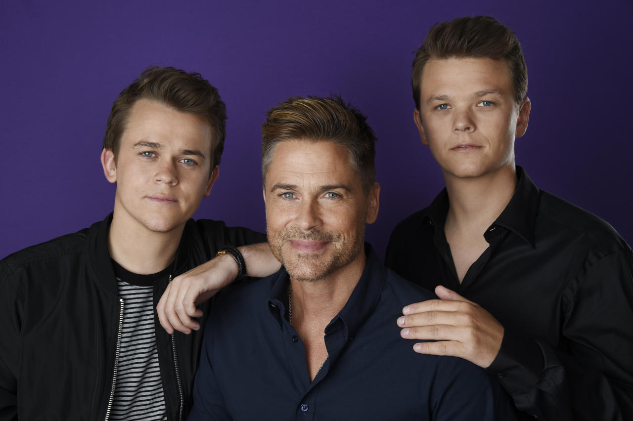 "Rob Lowe, center, and his two sons John Owen, left, and Matthew, cast members in the A&E series ""The Lowe Files,"" pose for a portrait during the 2017 Television Critics Association Summer Press Tour at the Beverly Hilton on Friday, July 28, 2017, in Beverly Hills, Calif. (Photo by Chris Pizzello/Invision/AP)"