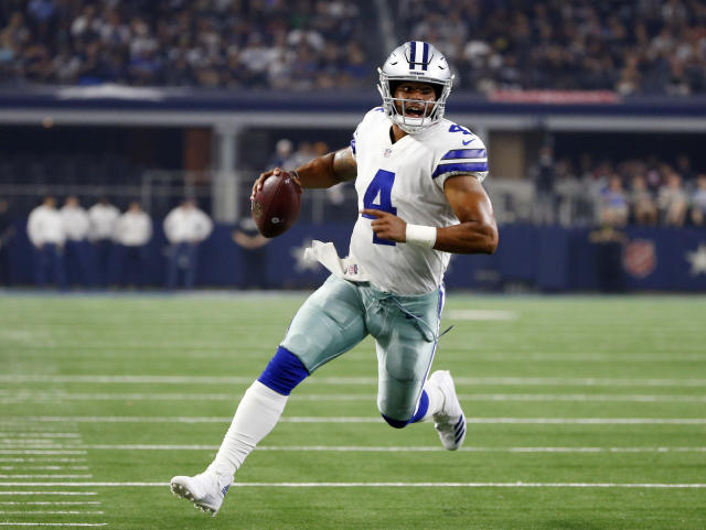 FILE - In this Aug. 18, 2018, file photo, Dallas Cowboys quarterback Dak Prescott (4) scrambles during the first half of a preseason NFL football game against the Cincinnati Bengals, in Arlington, Texas. Prescott dealt with the uncertainty of running back Ezekiel Elliotts looming six-game suspension last year when the Dallas Cowboys slid from an NFC-best 13 wins to out of the playoffs. Now the star quarterback faces the unknown of a revamped and largely unproven group of receivers after the departures of Jason Witten and Dez Bryant. Elliott, Prescotts fellow rookie standout from two years ago, is the supposed sure thing for a team looking up in the NFC East at defending Super Bowl champ Philadelphia.(AP Photo/Ron Jenkins, File)