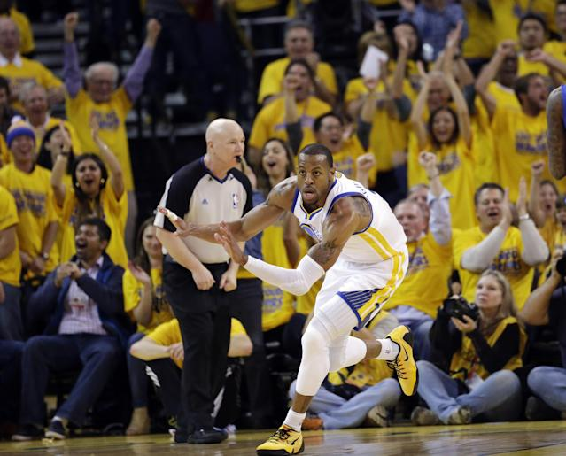Golden State Warriors' Andre Iguodala celebrates after scoring against the Los Angeles Clippers during the first half in Game 4 of an opening-round NBA basketball playoff series on Sunday, April 27, 2014, in Oakland, Calif. (AP Photo/Marcio Jose Sanchez)
