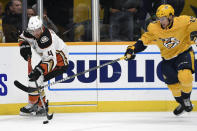 Anaheim Ducks defenseman Cam Fowler (4) maneuvers the puck ahead of Nashville Predators right wing Miikka Salomaki (20), of Finland, during the first period of an NHL hockey game Tuesday, Oct. 22, 2019, in Nashville, Tenn. (AP Photo/Mark Zaleski)