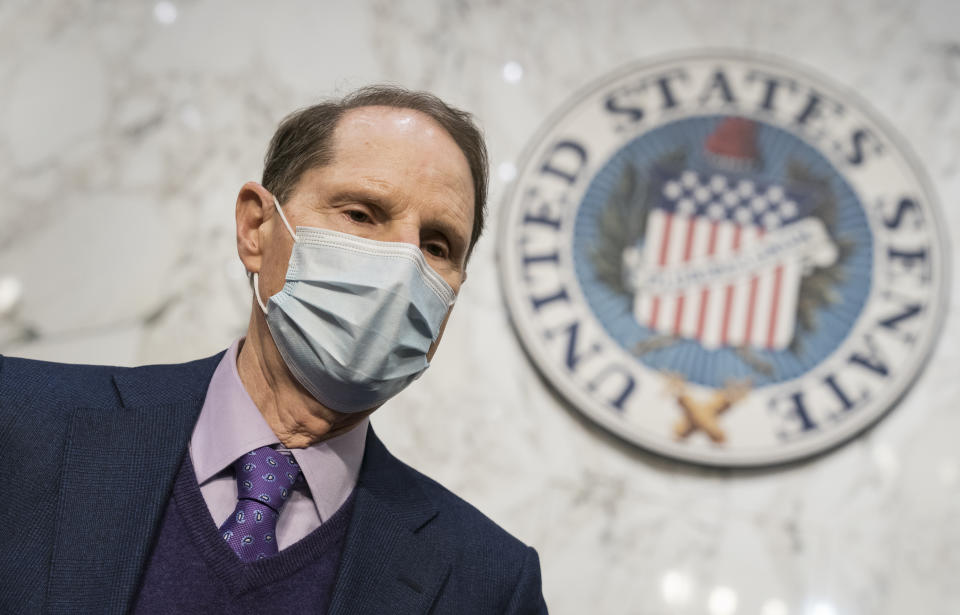Sen. Ron Wyden, D-Ore., chair of the Senate Finance Committee, prepares the panel for a vote on Xavier Becerra, President Joe Biden's Health and Human Services Dept. nominee, at the Capitol in Washington, Wednesday, March 3, 2021. (AP Photo/J. Scott Applewhite)