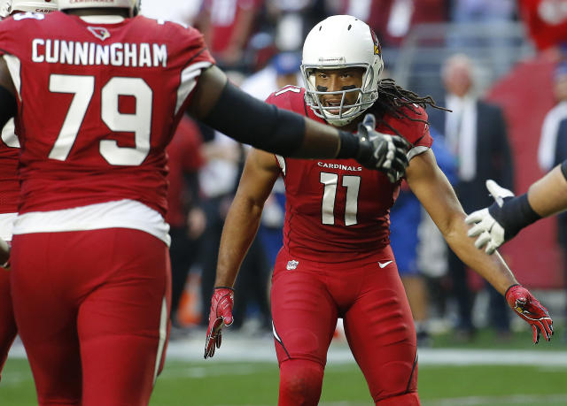 Arizona Cardinals wide receiver Larry Fitzgerald (11) celebrates his touchdown pass with teammates against the Los Angeles Rams during the first half of an NFL football game, Sunday, Dec. 23, 2018, in Glendale, Ariz. (AP Photo/Rick Scuteri)