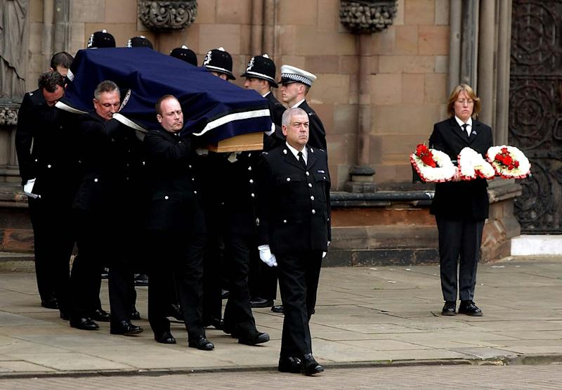 The coffin leaving Lichfield Cathedral after the funeral service of Det Con Michael Swindells, Lichfield,. The former Royal Engineers lance corporal from Burton-on-Trent, Staffs, died in hospital on May 21 from a single stab wound to the abdomen after being attacked in the Nechells area of Birmingham. (Photo by Rui Vieira - PA Images/PA Images via Getty Images)