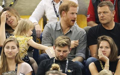 Emily spots her moment when Prince Harry is deep in conversation - Credit: Chris Jackson/Getty