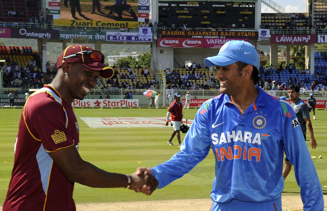 Dwayne Bravo captain of West Indies and Mahendra Singh Dhoni captain of India during the toss before the start of the second Star Sports One Day International (ODI) match between India and The West Indies held at the Dr. Y.S. Rajasekhara Reddy ACA-VDCA Cricket Stadium, Vishakhapatnam, India on the 24th November 2013  Photo by: Pal Pillai - BCCI - SPORTZPICS   Use of this image is subject to the terms and conditions as outlined by the BCCI. These terms can be found by following this link:  https://ec.yimg.com/ec?url=http%3a%2f%2fsportzpics.photoshelter.com%2fgallery%2fBCCI-Image-Terms%2fG0000ahUVIIEBQ84%2fC0000whs75.ajndY&t=1490321845&sig=bzODLBrhhDS8TIpkthM7DQ--~C
