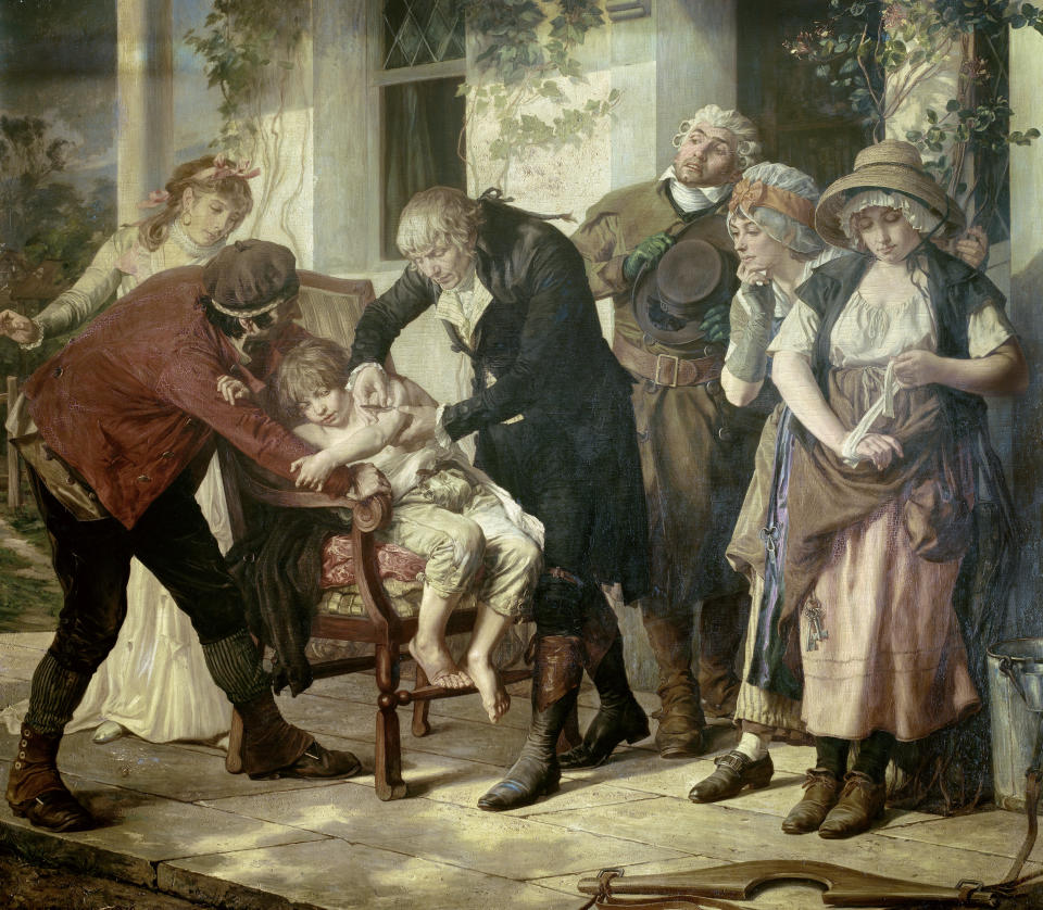 Melingue Gaston ( 1840 - 1914 ) (Jenner takes pus from the hand of a farmer with vaccinia, then inoculates young eight year old James Philips, and two months later inoculates the smallpox virus with the child.) The first vaccination of Edward Jenner in 1796 (1749 - 1823) painted in 1879  Academy of Medicine of Paris. (Photo by: Christophel Fine Art/Universal Images Group via Getty Images)