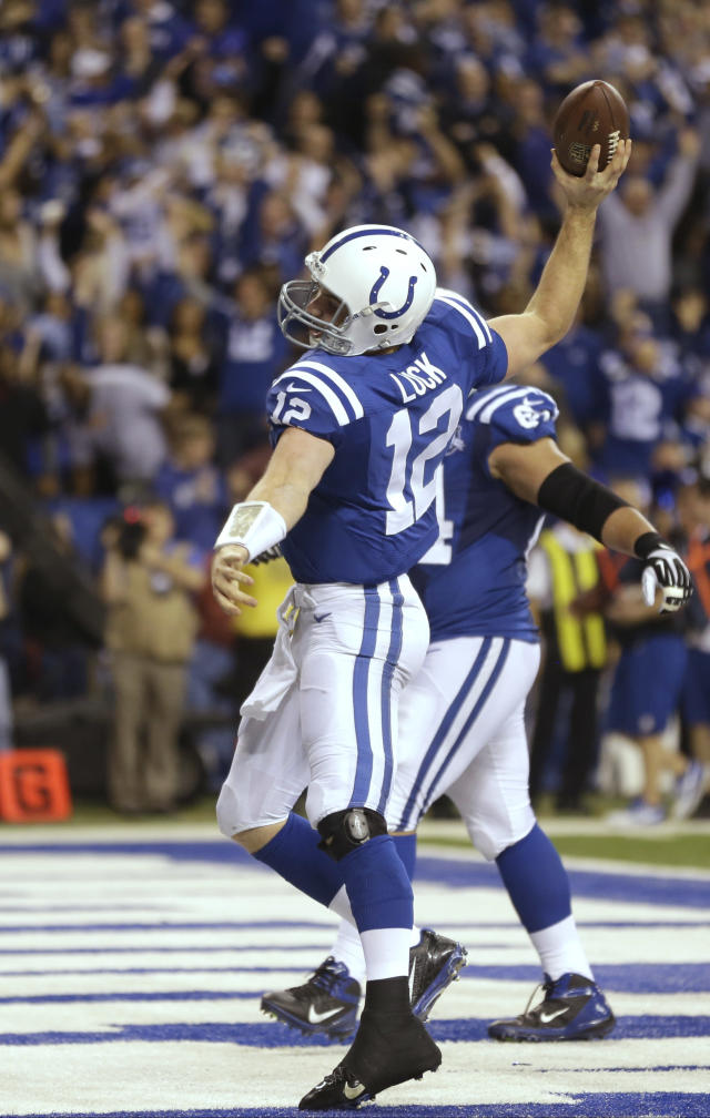 Indianapolis Colts quarterback Andrew Luck (12) celebrates after scoring a touchdown against the Kansas City Chiefs during the second half of an NFL wild-card playoff football game Saturday, Jan. 4, 2014, in Indianapolis. (AP Photo/Michael Conroy)