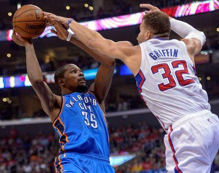 May 9, 2014; Los Angeles, CA, USA;Los Angeles Clippers forward Blake Griffin (32) blocks a shot by Oklahoma City Thunder forward Kevin Durant (35) during the second quarter of game three of the second round of the 2014 NBA Playoffs at Staples Center. Mandatory Credit: Robert Hanashiro-USA TODAY Sports
