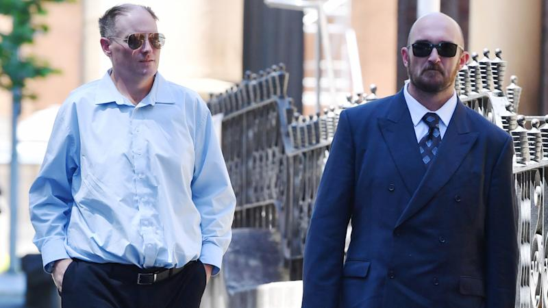 Brothers David (left) and Philip (right) Thompson arrive at the Supreme Court in Sydney, Friday, Octover 18, 2019. The brothers are accused of the manslaughter of their mother whilst she was in palliative care. (AAP Image/Dean Lewins)