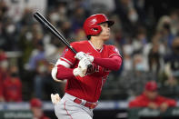 Los Angeles Angels' Shohei Ohtani watches the path of his solo home run against the Seattle Mariners in the first inning of a baseball game Sunday, Oct. 3, 2021, in Seattle. (AP Photo/Elaine Thompson)