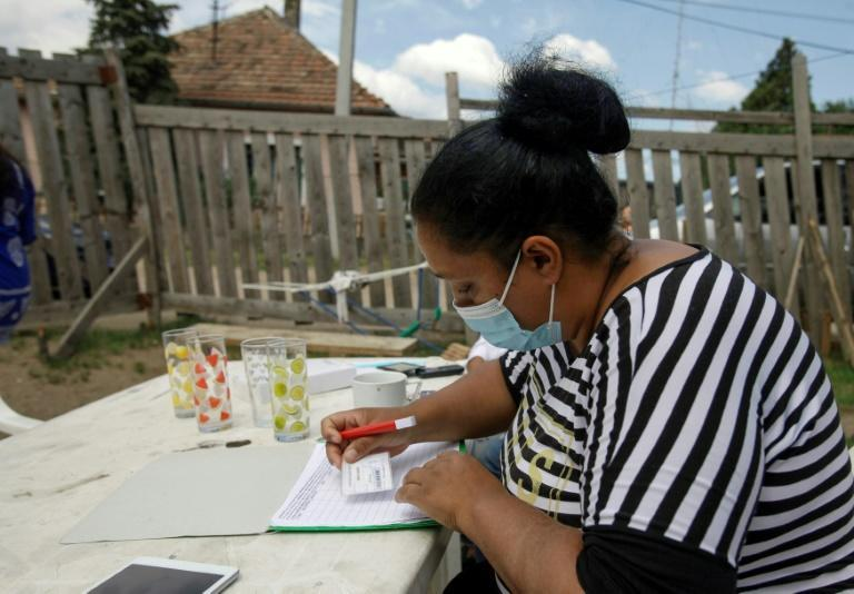 A woman registers for the Covid-19 vaccination in Kistarcsa near Budapest, Hungary