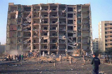 FILE PHOTO: Investigators inspect the Khobar Towers military complex after an attack in Khobar