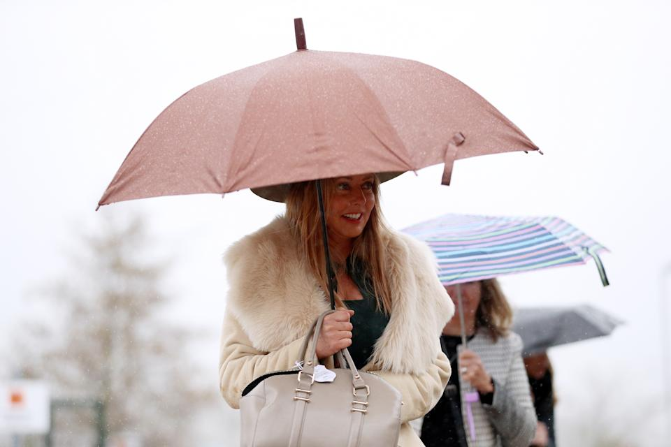 Carol Vorderman (centre) arrives for Champion Day of the 2019 Cheltenham Festival at Cheltenham Racecourse. (Photo by Andrew Matthews/PA Images via Getty Images)