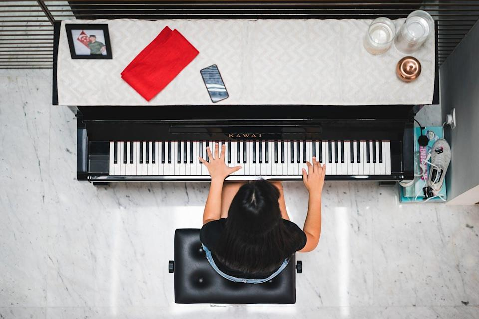 Person playing a piano shot from above