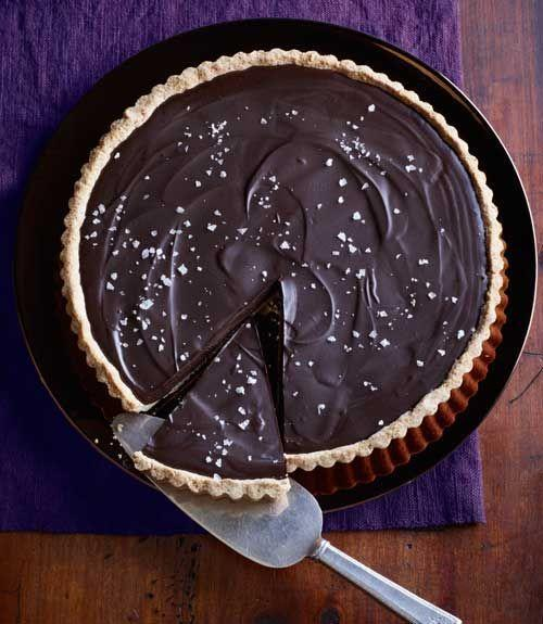 "<p>This dark and rich chocolate ganache is only three ingredients. Pour it over a homemade almond crust for the perfect decadent fall dessert.</p><p><em><a href=""https://www.goodhousekeeping.com/food-recipes/a14001/ganache-tart-salted-almond-crust-recipe-ghk0212/"" rel=""nofollow noopener"" target=""_blank"" data-ylk=""slk:Get the recipe for Ganache Tart with Salted-Almond Crust »"" class=""link rapid-noclick-resp"">Get the recipe for Ganache Tart with Salted-Almond Crust »</a></em> </p>"