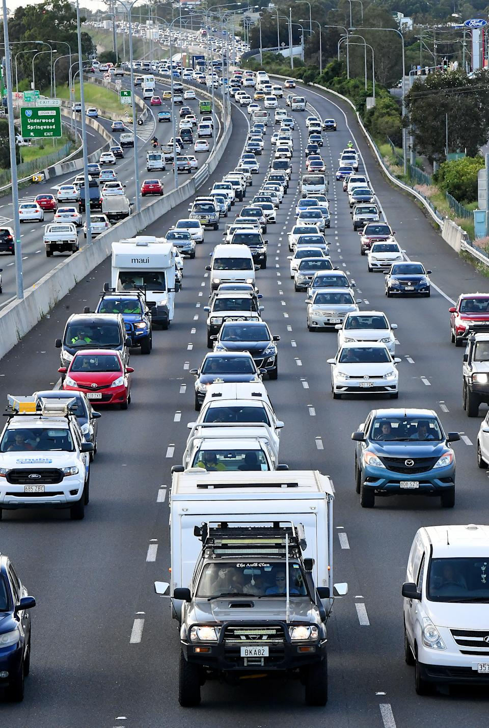 Traffic is seen leaving Brisbane towards the Gold Coast at the Pacific Highway at Logan, Monday, as the lockdown was confirmed. Source: AAP