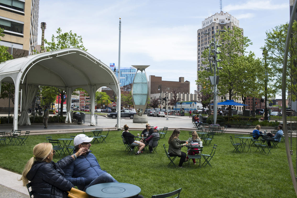 Locals enjoy Campus Martius, a Detroit public park where billionaire Dan Gilbert's office sits. Gilbertnow owns a large share of the buildings in downtown. (Photo: Brittany Greeson for Yahoo News)