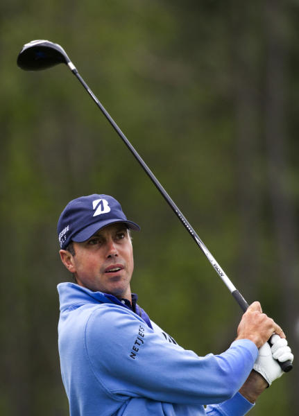 Matt Kuchar hits off the tee on the eighth hole during the third round of the Houston Open golf tournament on Saturday, April 5, 2014, in Humble, Texas. (AP Photo/Patric Schneider)
