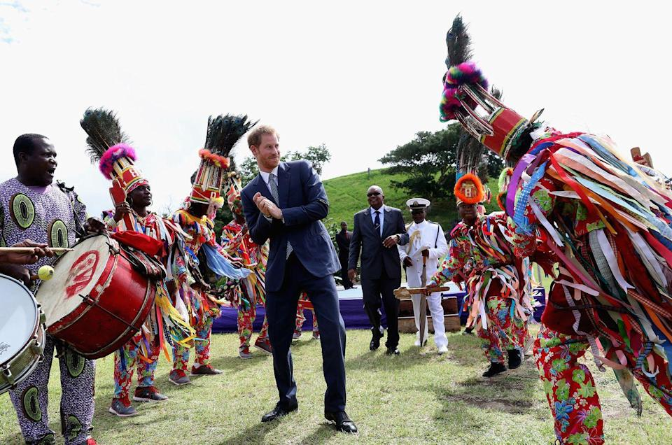 <p>Prince Harry watches dancers at Brimstone Fortress during a youth rally on an official visit to Port Zante, St Kitts, and Nevis.</p>