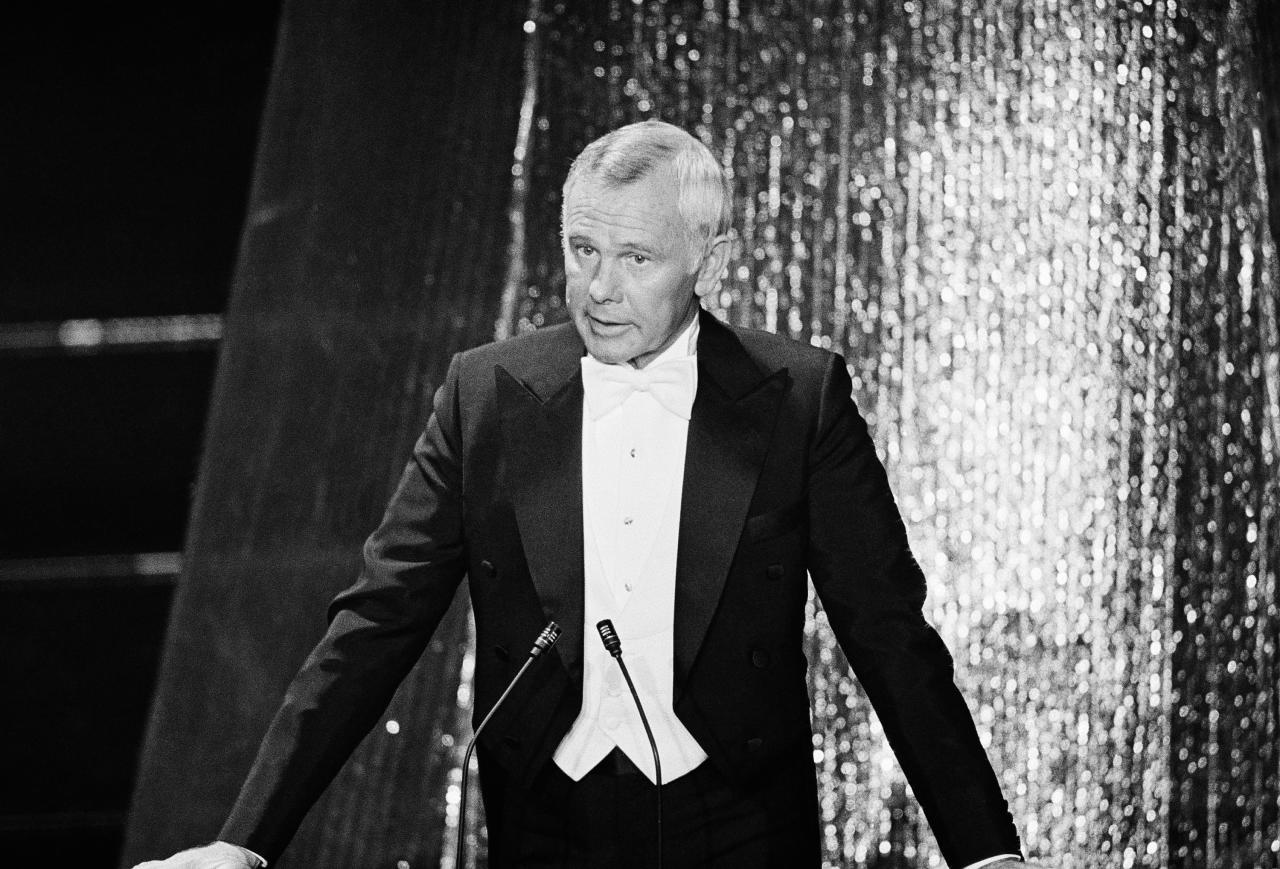 """The great Johnny Carson of Tonight Show fame hosted the Emmy's from 1971 to 1974.  Though there are plenty of great Carson zingers to choose from, a timely and memorable one came at the 1972 Awards.  Said Carson: """"The heads of the three networks are sitting out there - separated only by their food tasters.""""  Here, Carson was hitting a very tender nerve.  In 1972, the Justice Department filed an antitrust lawsuit against all three networks, CBS, NBC, and ABC.  The suit accused the networks of monopolizing prime-time TV programming and attempted to bar them from carrying network-produced entertainment programs, including feature films.  ABC played the Watergate card, arguing that the lawsuit was an attempt to suppress the three networks, in retaliation for press """"harassment"""" of Nixon.  The lawsuit was dismissed in 1974, but the era of a three-network monopoly was effectually over.  1972 saw the launch of the nation's first pay-TV network, Home Box Office (HBO) and the subsequent creation of a national satellite distribution system.  The age of cable had begun.  (Associated Press)"""