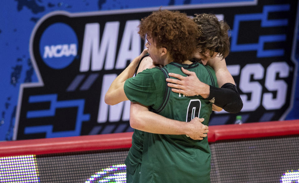 Ohio guard Jason Preston (0) and forward Ben Vander Plas (5) celebrate their defeat of Virginia. (AP Photo/Doug McSchooler)