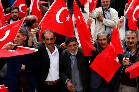 People wave Turkey's national flags during a rally organised by village guards in Cermik, a town in southeastern province of Diyarbakir, Turkey, March 10, 2017. Picture taken March 10, 2017. REUTERS/Umit Bektas