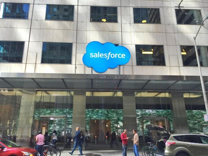 A building entrance with the Salesforce logo above the door.