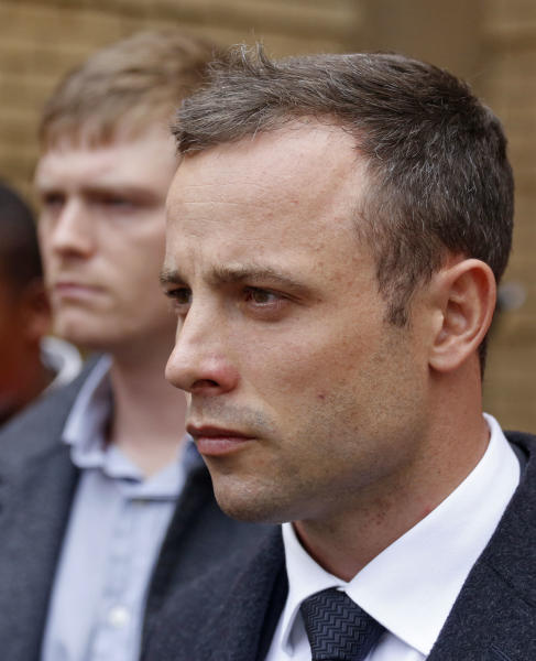 Oscar Pistorius, leaves the high court after the fifth day of his trial in Pretoria, South Africa, Friday, March 7, 2014. Pistorius is charged with murder in the shooting death of girlfriend Reeva Steenkamp in the pre-dawn hours of Valentine's Day 2013. (AP Photo/Schalk van Zuydam)