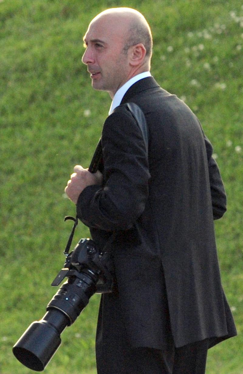 In this undated file photo Georgian President Mikhail Saakashvili's personal photographer Irakli Gedenidze seen in Tbilisi, Georgia. Georgian police say the personal photographer of the country's president has been arrested on suspicion of espionage, along with two other photographers. A brief statement on the Interior Ministry's website Thursday said the detainees were Irakli Gedenidze, the photographer for Georgian President Mikhail Saakashvil; Zurab Kurtsikidze of the European Pressphoto Agency; Foreign Ministry photographer Georgy Abdaladze. Gedenidze's wife also was arrested.  The statement said they were suspected of sending information harmful to Georgia to an unspecified foreign country. Associated Press photographer Skakh Aivazov was also held in the early Thursday detentions, but was released after several hours without charges. (AP Photo/Vano Shlamov, Pool)