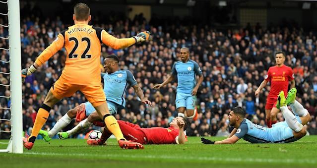 <p>Raheem Sterling misses a tap in before Fernandinho hits the side netting with the goal gaping </p>
