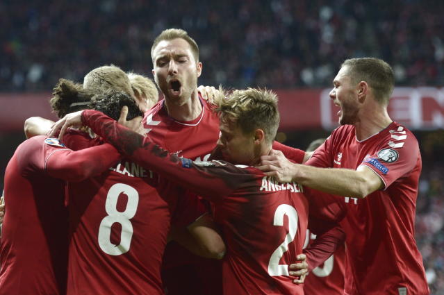 Danish players celebrate after Yussuf Yurary Poulsen scored the winning goal during the Euro 2020, Group qualifying soccer match between Denmark and Switzerland in Telia Parken in Copenhagen Saturday, Oct. 12, 2019. (Liselotte Sabroe/Ritzau Scanpix via AP)