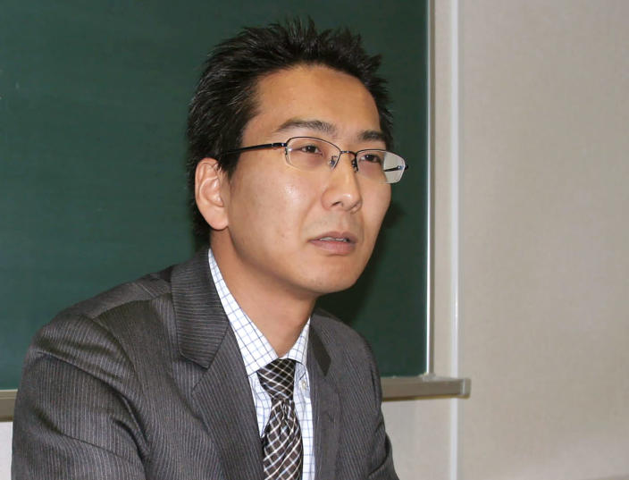 FILE - In this file photo dated April 1, 2013, Journalist Yuki Kitazumi speaks during an interview in Fukuoka, southwestern Japan. Myanmar's ruling junta said Thursday May 13, 2021, that as a gesture of friendship with Tokyo, it will free Japanese freelance journalist Yuki Kitazumi who was jailed and charged with spreading false news or information that could cause public unrest. (Kyodo News FILE via AP)