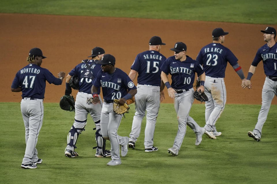 Seattle Mariners celebrate a 6-2 win against the Los Angeles Angels in a baseball game in Anaheim, Calif., Thursday, June 3, 2021. (AP Photo/Jae C. Hong)