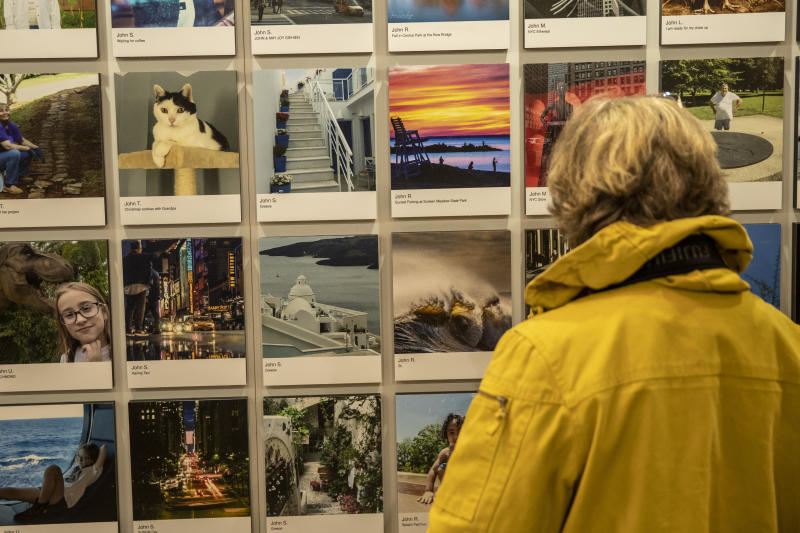 A woman admires several of the beautiful landscapes on exhibit at Vanderbilt Hall. (Photo: Gordon Donovan/Yahoo News)