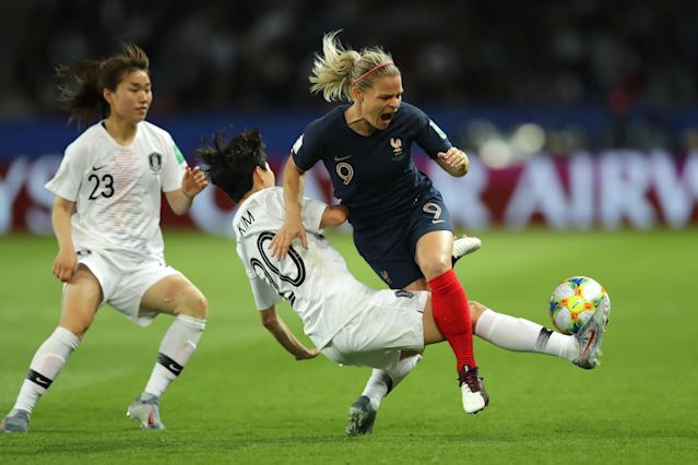 Eugenie Le Sommer of France is challenged by Hyeri Kim of Korea Republic during the 2019 FIFA Women's World Cup France group A match between France and Korea Republic at Parc des Princes on June 07, 2019 in Paris, France. (Photo by Richard Heathcote/Getty Images)