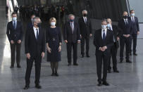 U.S. Secretary of State Antony Blinken, fourth right, and NATO Secretary General Jens Stoltenberg, third left, wear protective masks as they stand with NATO foreign ministers for a socially distanced group photo during a meeting of NATO foreign ministers at NATO headquarters in Brussels, Tuesday, March 23, 2021. (Yves Herman, Pool via AP)