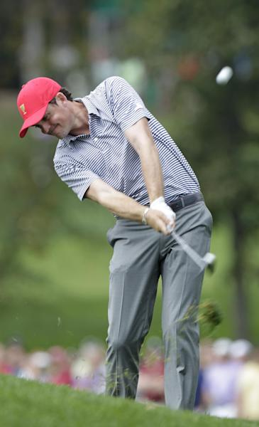 United States' Keegan Bradley hits his approach shot on the first hole during a foursome match against the International team at the Presidents Cup golf tournament at Muirfield Village Golf Club Friday, Oct. 4, 2013, in Dublin, Ohio. (AP Photo/Jay LaPrete)