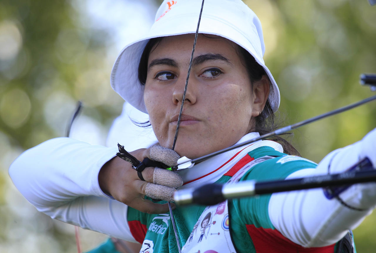 OGDEN, UT - JUNE 21:  Alejandra Valencia from Mexico competes in the 2012 Archery World Cup, Olympic team qualifying event June 21, 2012 at the Golden Spike Event Center in Ogden, Utah. Mexico women team took second place and qualified for the Olympics in London. (Photo by George Frey/Getty Images)