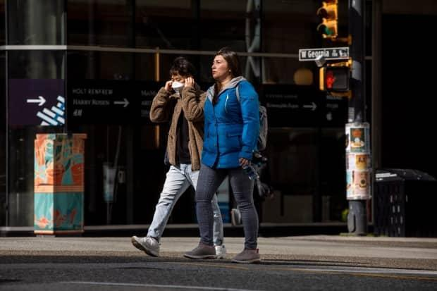 People go about their business in downtown Vancouver, British Columbia on Tuesday, April 6, 2021.  (Ben Nelms/CBC - image credit)