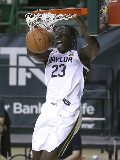Baylor forward Jonathan Tchamwa Tchatchoua (23) dunks the ball against Central Arkansas in the first half of an NCAA college basketball game, Tuesday, Dec. 29, 2020, in Waco, Texas. (AP Photo/ Jerry Larson)