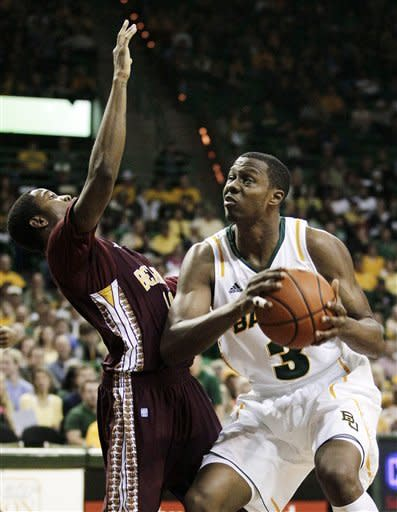 Baylor forward Fred Ellis (3) drives for position against Bethune-Cookman guard Stanley Elliott, left, in the first half of an NCAA college basketball game, Wednesday, Dec. 14, 2011, in Waco, Texas. Baylor won 69-42. (AP Photo/Tony Gutierrez)