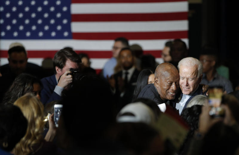 Former Vice President and Democratic presidential candidate Joe Biden, right, embraces a supporter at a campaign event, Saturday, Nov. 16, 2019, in Las Vegas. (AP Photo/John Locher)