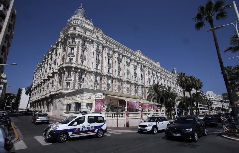 A view of the Carlton hotel, in Cannes, southern France, the scene of a daylight raid, Sunday, July 28, 2013. A staggering 40 million euro ($53 million) worth of jewels and diamonds were stolen Sunday from the Carlton Intercontinental Hotel in Cannes, in one of Europe's biggest jewelry heists recent years, police said. French Riviera hotel was hosting a temporary jewelry exhibit over the summer of the prestigious Leviev diamond house, which is owned by Israeli billionaire Lev Leviev. (AP Photo/Lionel Cironneau)