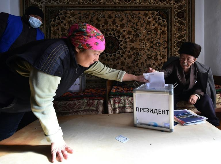 A woman casts her ballot during early voting in Arashan, outside Bishkek, as Kazakhs embark on their first elections since a political crisis embroiled the ex-Soviet country in October