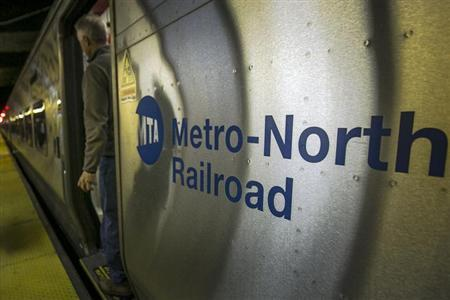 A morning commuter exits a Metro-North Hudson line train at Grand Central Station in New York