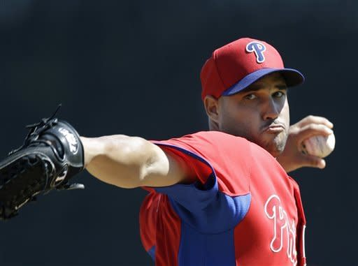 Philadelphia Phillies pitcher Raul Valdes (46) delivers a warm-up pitch before the start of a spring training baseball game against the New York Yankees at Steinbrenner Field in Tampa, Fla., Saturday, March 16, 2013. (AP Photo/Kathy Willens)