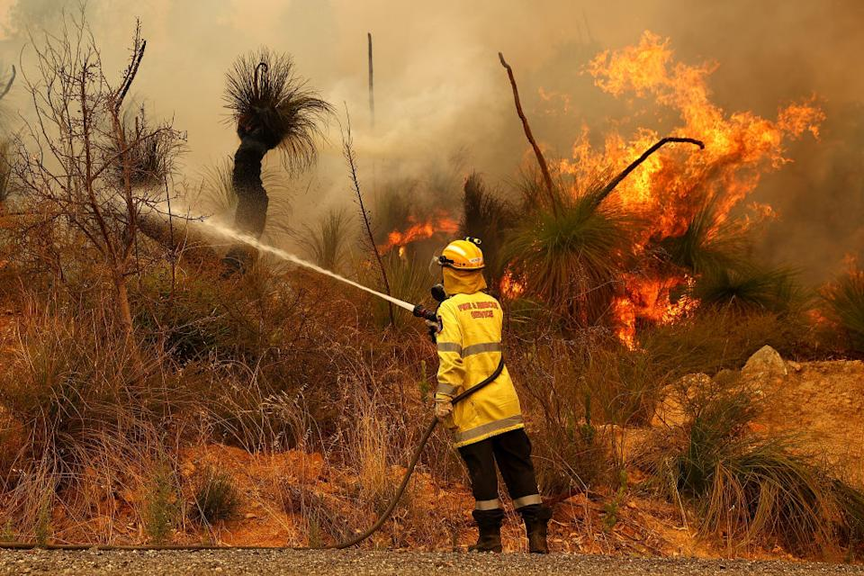Fire crews control bush fires as they approach properties on Copley Road in Upper Swan in Perth, Australia.