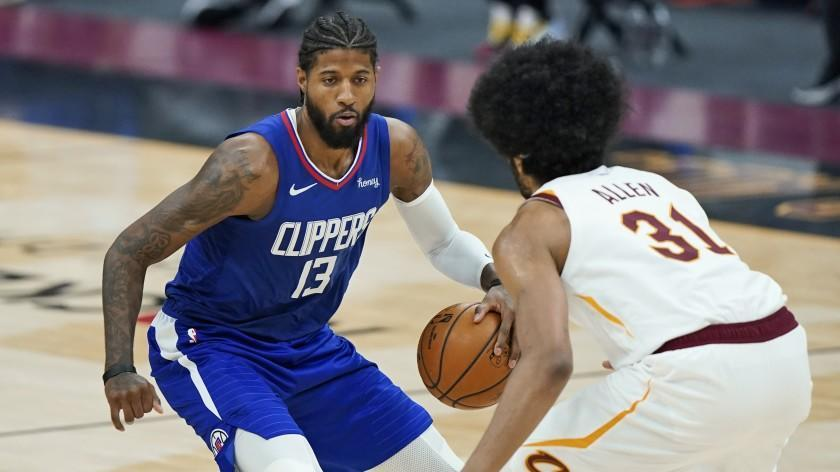 Los Angeles Clippers' Paul George (13) drives to the basket against Cleveland Cavaliers' Jarrett Allen.