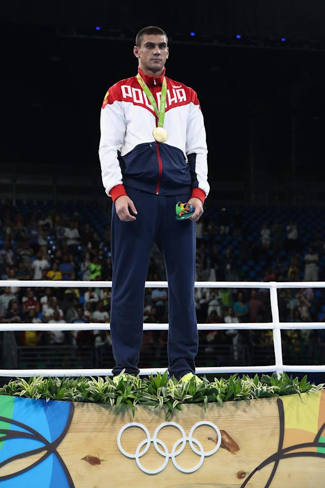 <p>Evgeny Tishchenko of Russia with the gold medal after winning the mens heavyweight 91kg during the Boxing at Riocentro on August 15, 2016 in Rio de Janeiro, Brazil (Getty) </p>