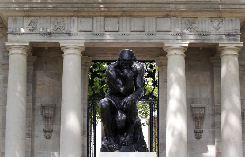 """Auguste Rodin's """"The Thinker"""" is displayed at the entrance to the grounds of the Rodin Museum on Wednesday, May 16, 2012, in Philadelphia. After a three-year renovation, the museum is scheduled to reopen to the public on July 13. (AP Photo/Alex Brandon)"""